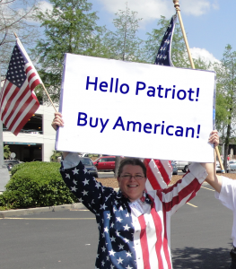 Connie holding sign to encourage patriots to Buy American!